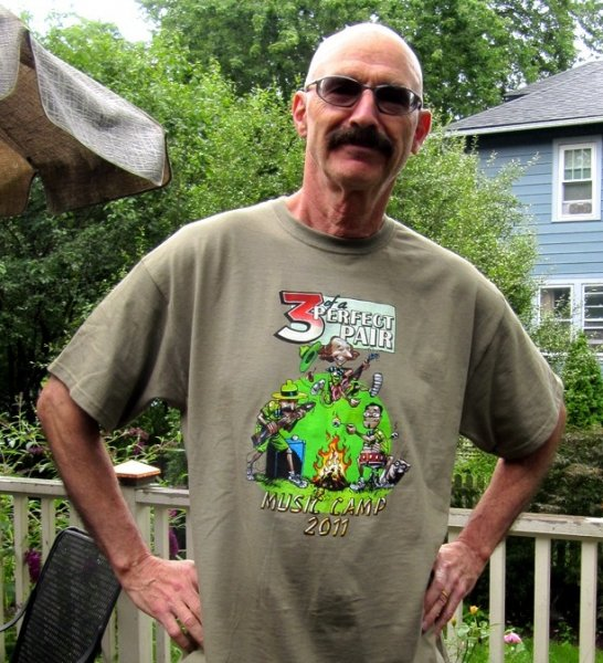 Tony levin with 3 of a Perfect Pair Camp t-shirt